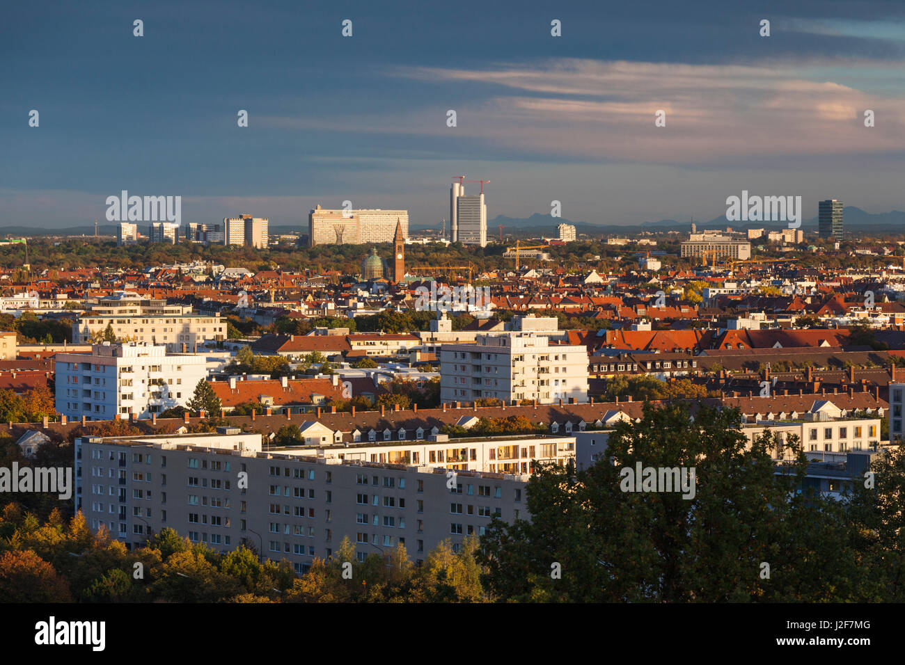 Germany, Bavaria, Munich, Olympic Park, fall city skyline from the Olympiaberg hill - Stock Image