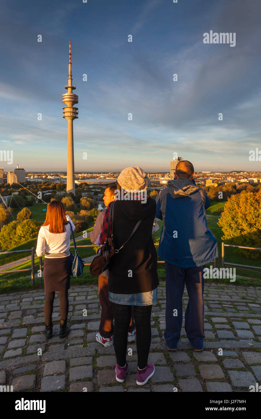 Germany, Bavaria, Munich, Olympic Park, Olympia Tower with people, sunset, fall Stock Photo