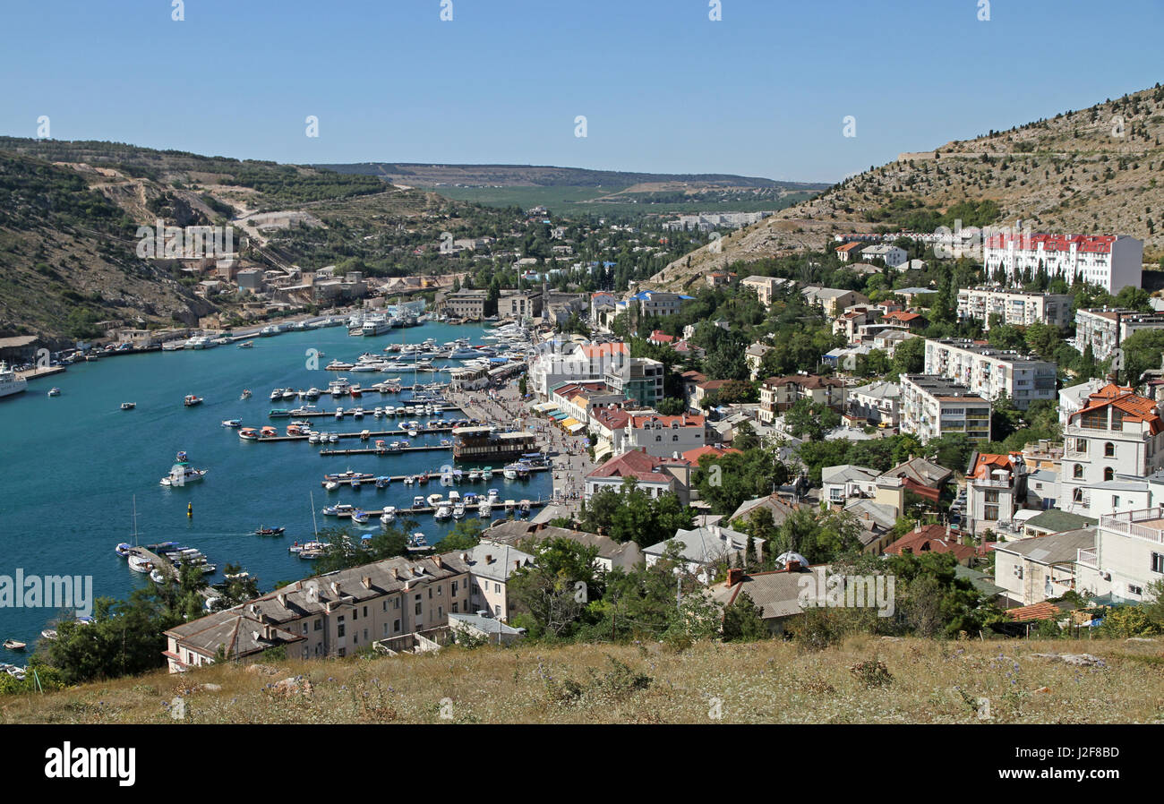 View towards the seaside resort of Balaklava from the hill with the Genovese Fortress - Stock Image