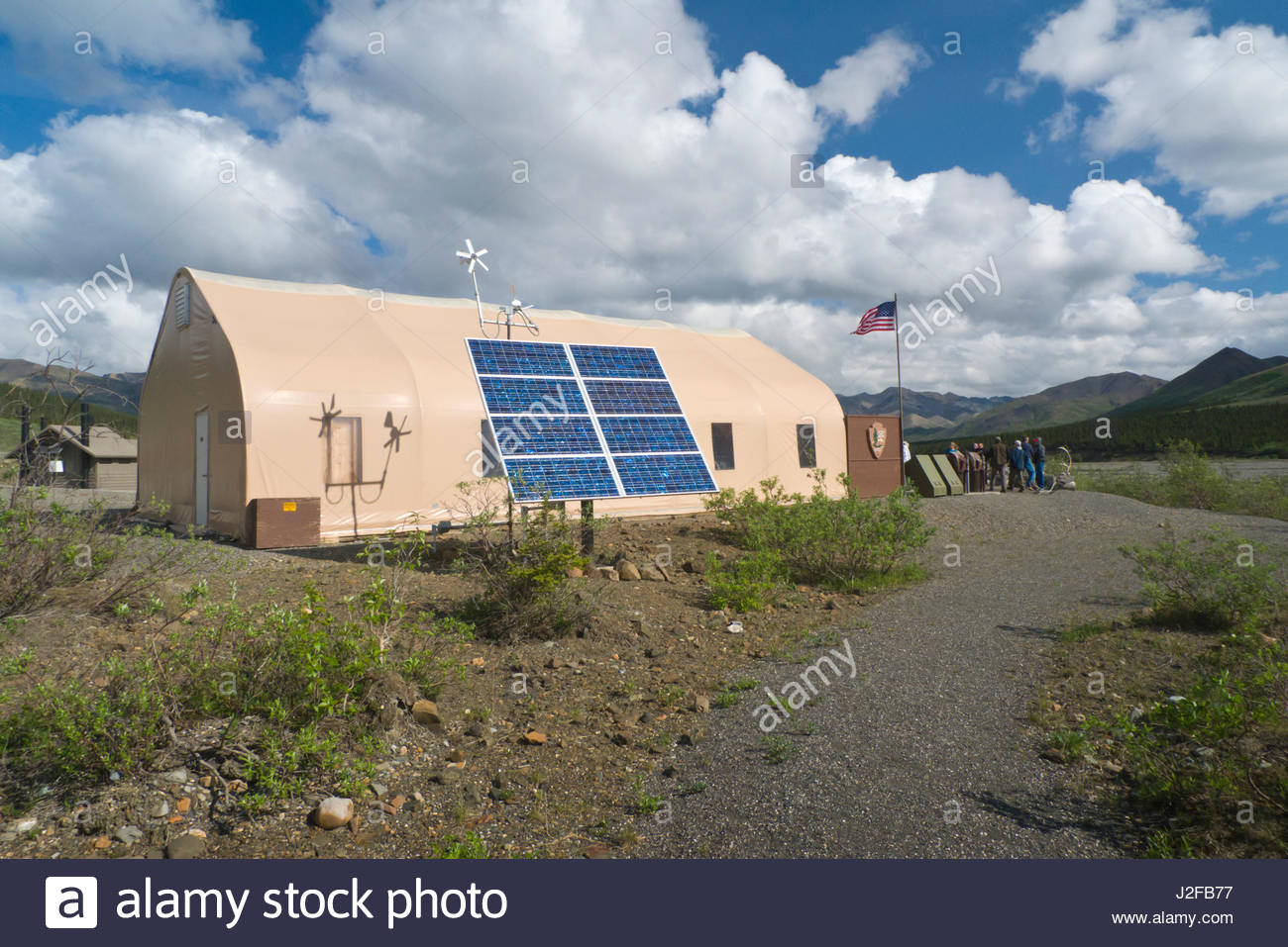Photovoltaic panels providing electric power to fabric building at Toklat River rest area, Denali National Park, - Stock Image