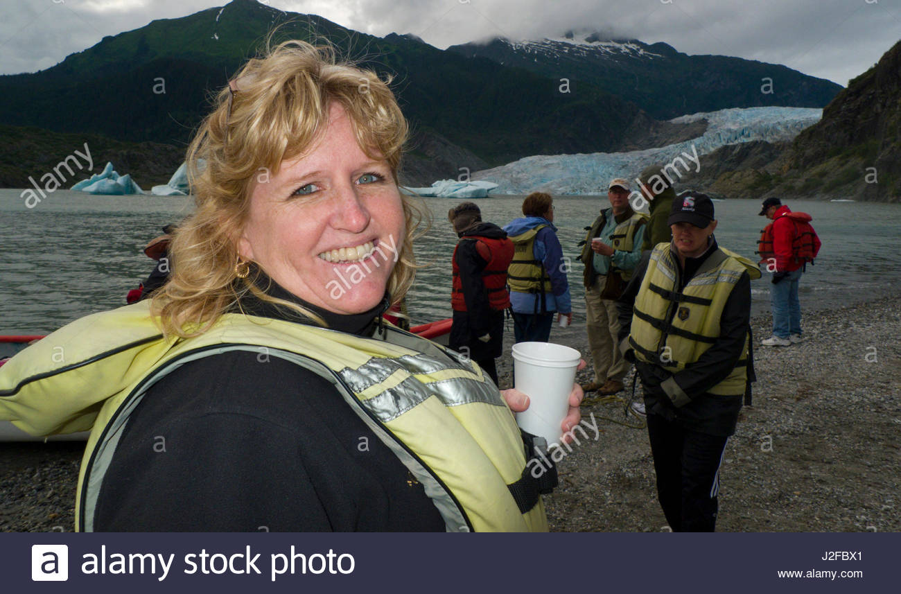 Mature Caucasian woman wearing a life vest smiling, Mendenhall Lake, Tongass National Forest, Juneau Borough, Alaska, - Stock Image
