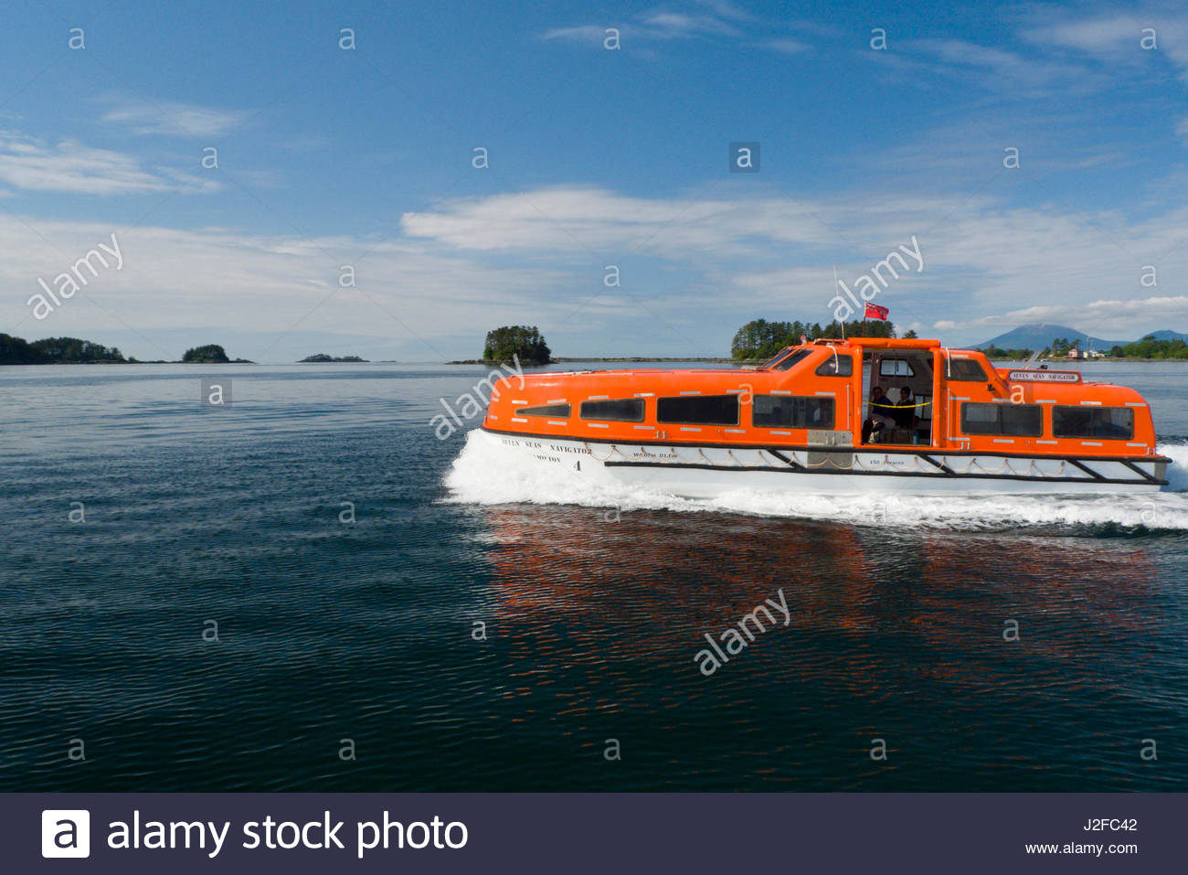 Orange ship tender ferrying passengers to and from Sitka, Regency Seven Seas Navigator Cruise Ship, Crescent Bay, - Stock Image