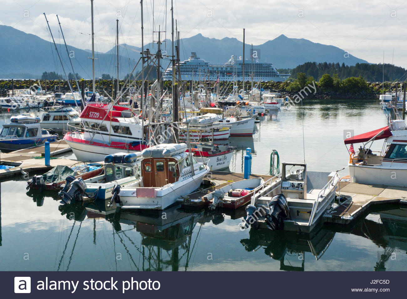 Small boats and yachts in berths on floating dock, Crescent Harbor, Sitka, Alaska, USA - Stock Image