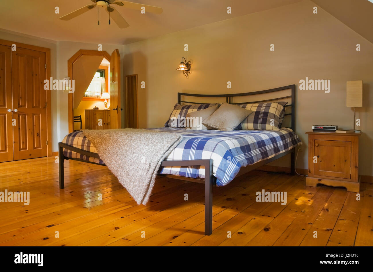 King Size Bed On Metal Frame In Master Bedroom With Partial Hexagon