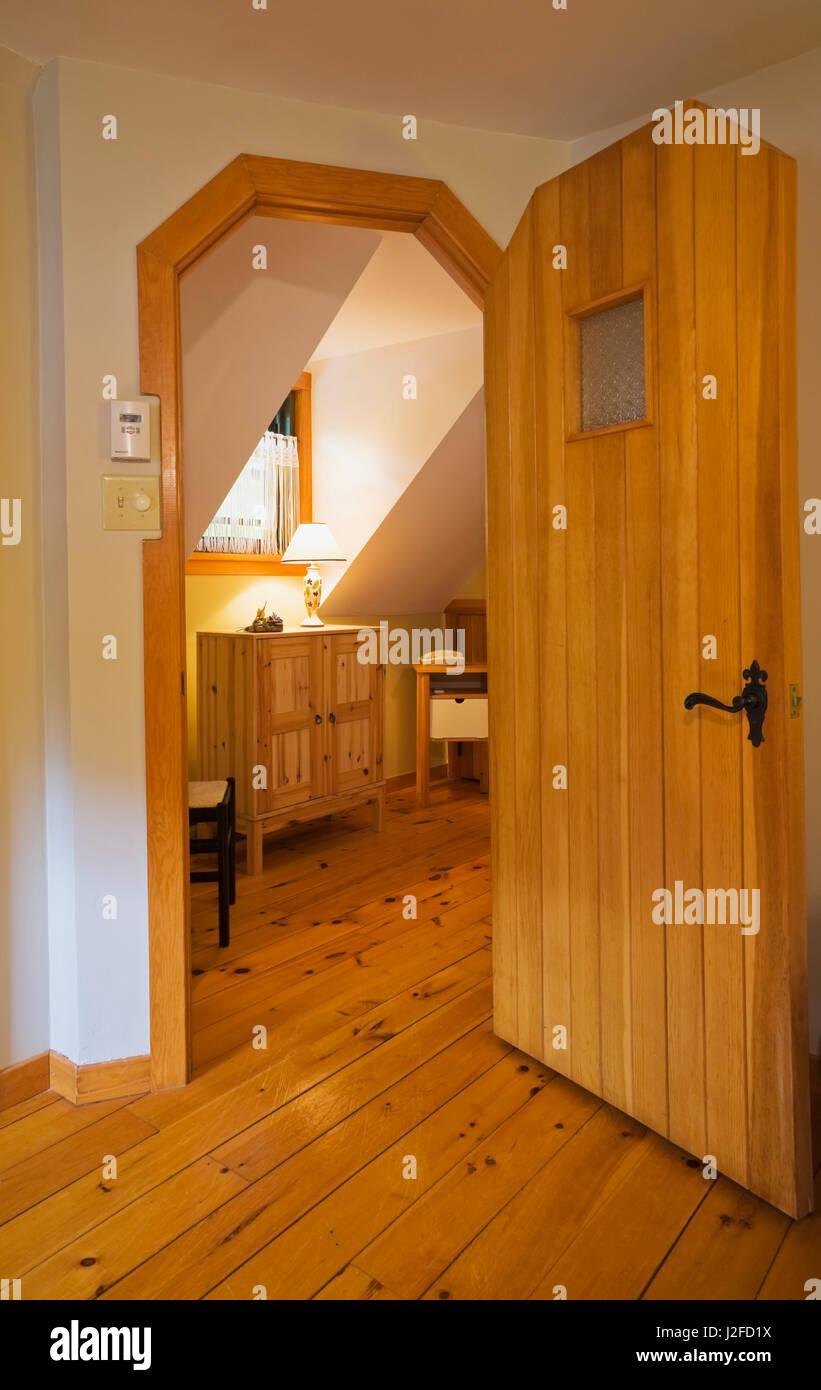 Half Hexagon Shaped Wooden Entrance Door In Master Bedroom Leading