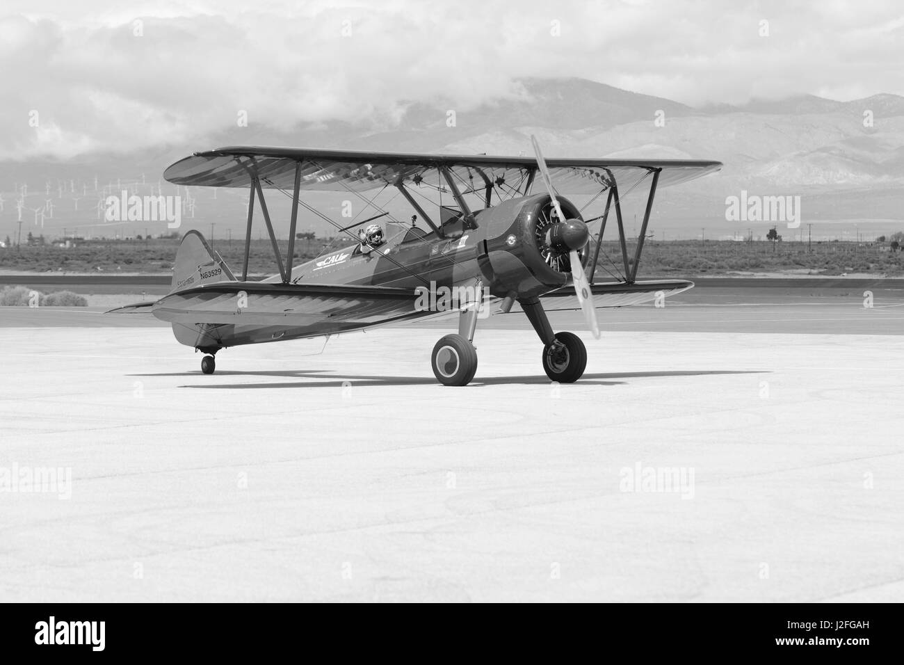 Lancaster, USA - March 25, 2017: Vicky Benzing taxiing her 1940 Boeing Stearman during Los Angeles County Air Show - Stock Image