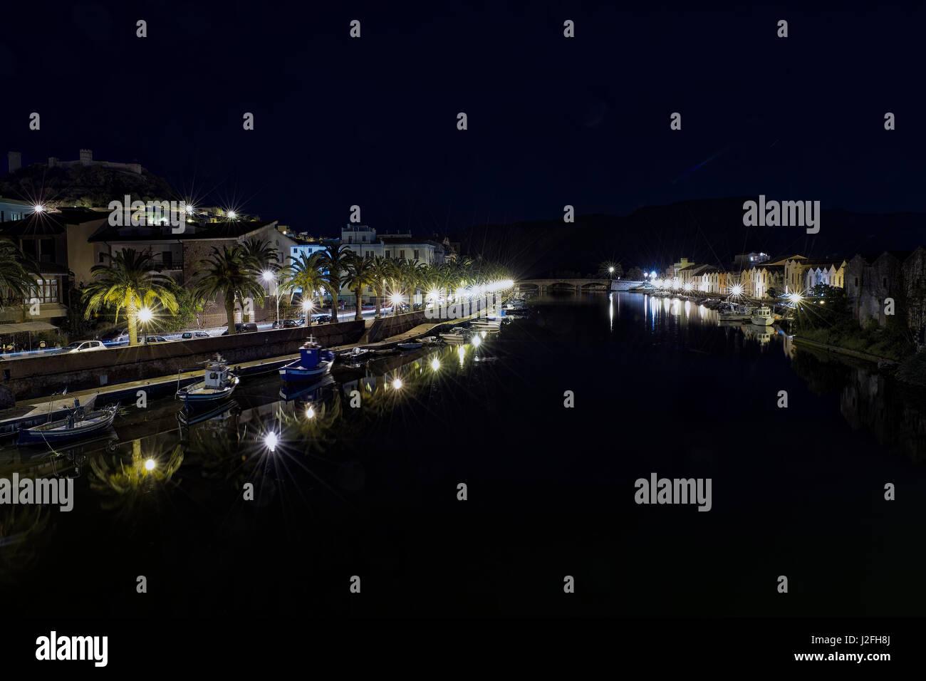 Night on Temo, river crossing the city of Bosa. Sardinia, Northwest Coast. - Stock Image