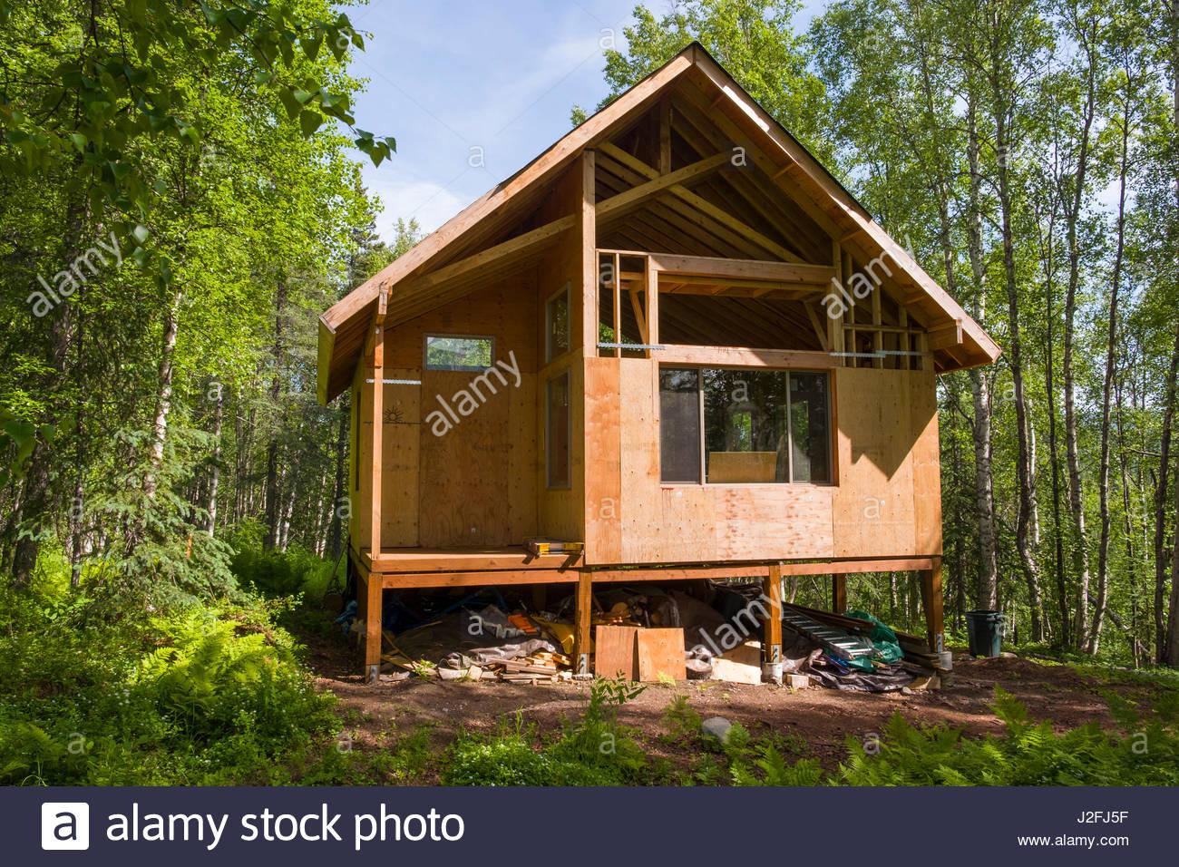 Remote off-grid Alaskan cabin under construction, Matanuska-Susitna, Alaska, USA - Stock Image