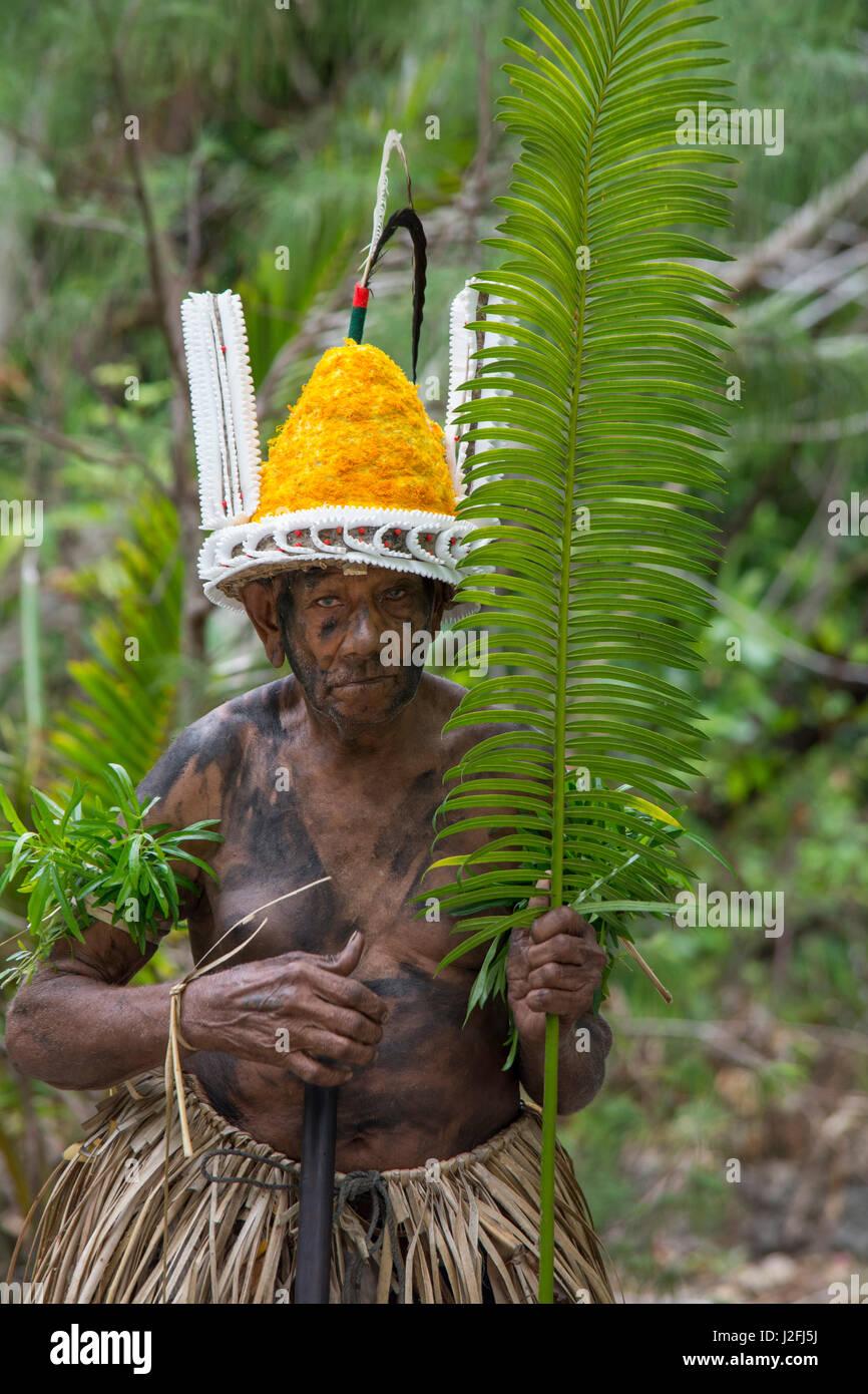 Republic of Vanuatu, Torres Islands, Loh Island. Village elder dressed in traditional headdress and palm attire - Stock Image