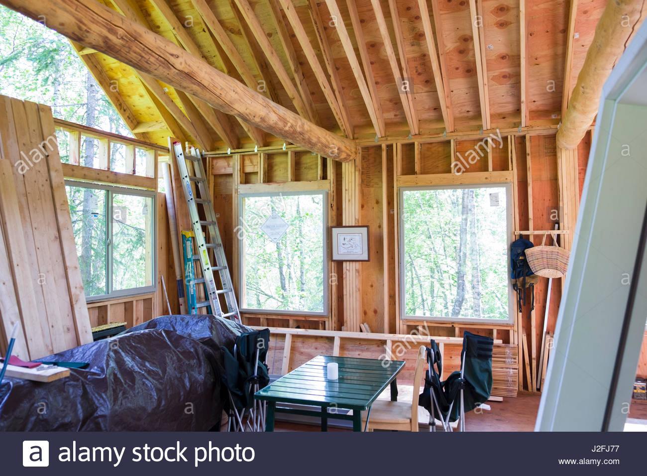 View of framing inside remote off-grid Alaskan cabin under construction, Matanuska-Susitna, Alaska, USA - Stock Image