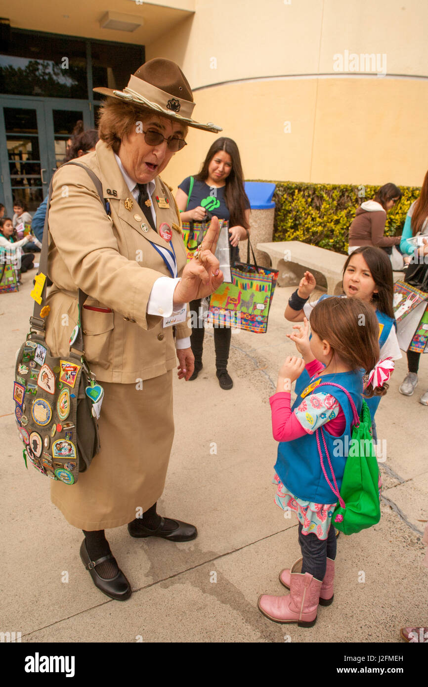 """A woman in a historic uniform portrays Girl Scouts founder """"Miss Daisy"""" Juliette Gordon Law and demonstrates the Stock Photo"""