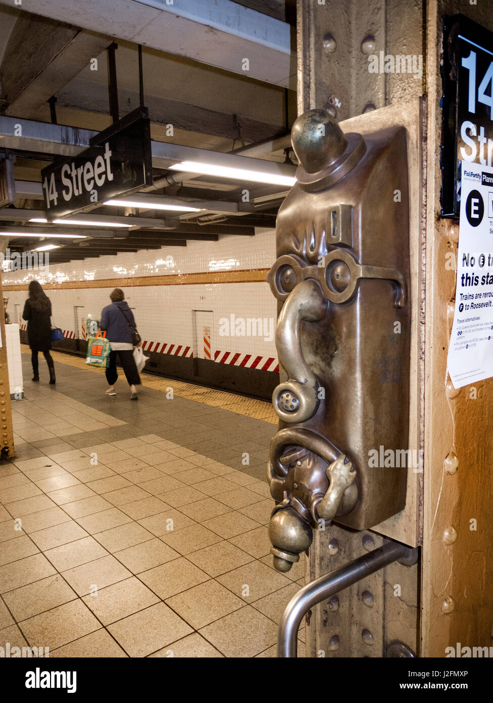 A funny face caricature on the 14th Street subway platform in Manhattan, New York City, is part of a decorative - Stock Image