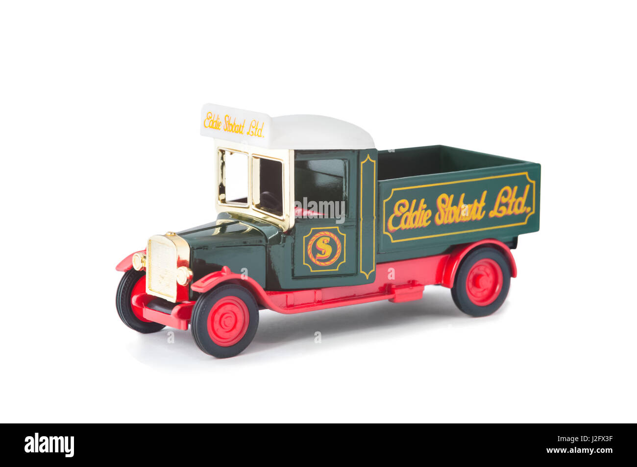 Vintage model pick-up truck manufactured by Corgi in Eddie Stobart livery on white - Stock Image
