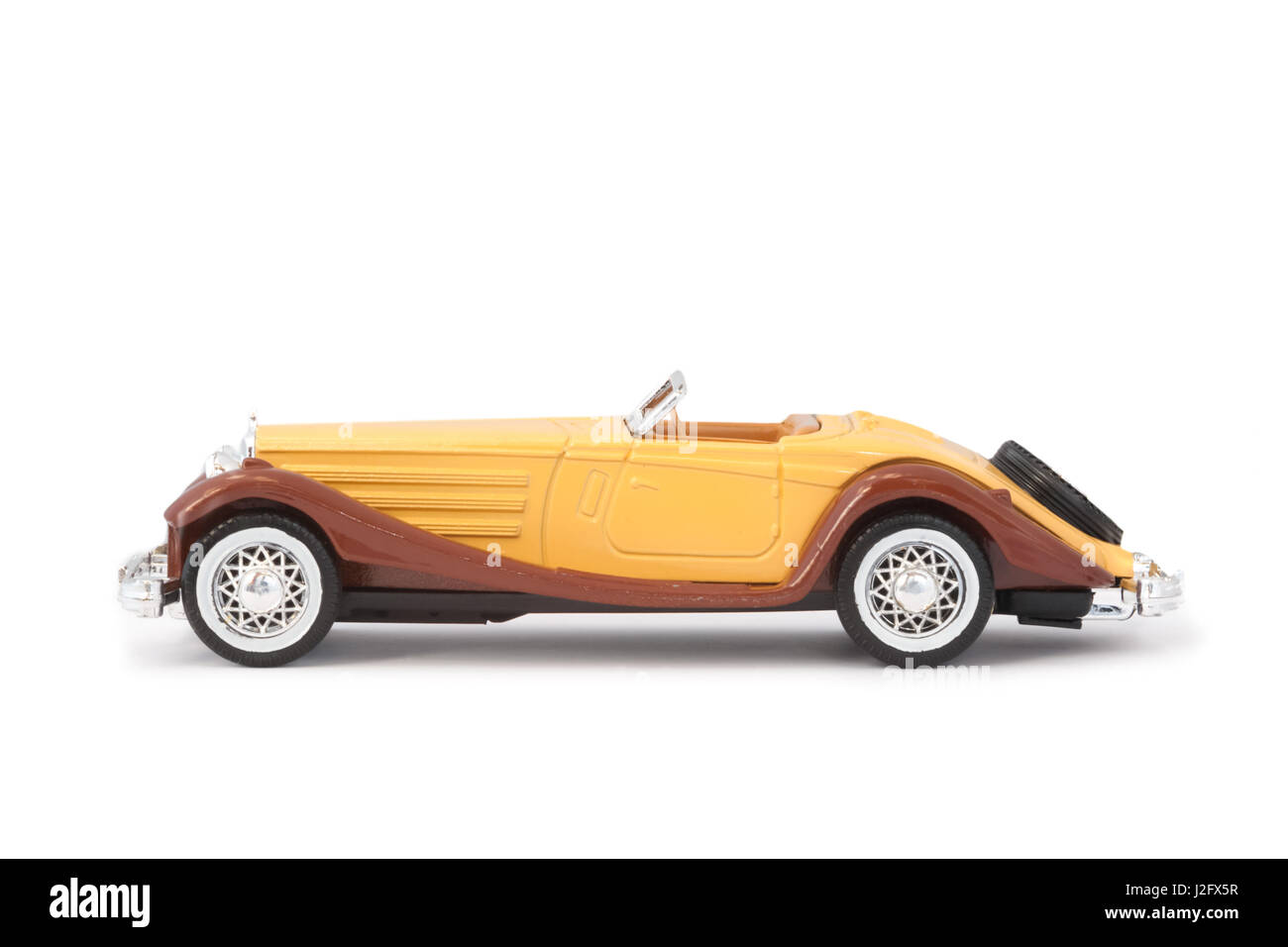 old miniature model sports car on white - Stock Image