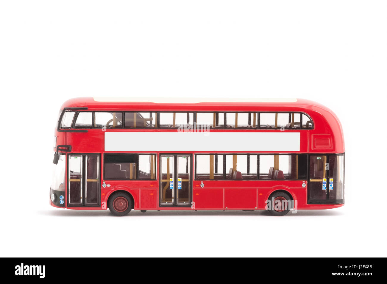 miniature model of a modern red london bus on a white background - Stock Image