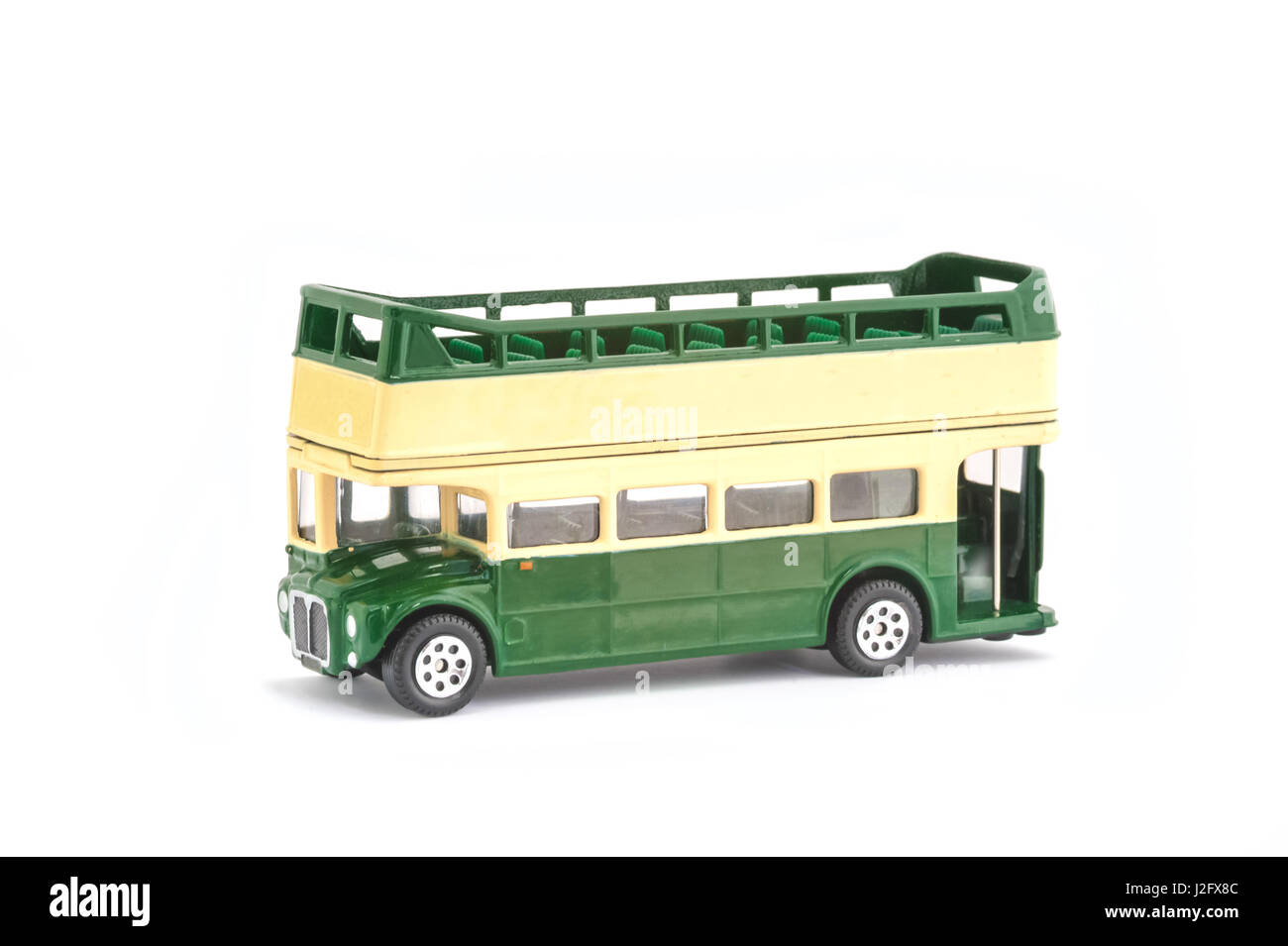 miniature scale model of a vintage open-top tour bus on white - Stock Image