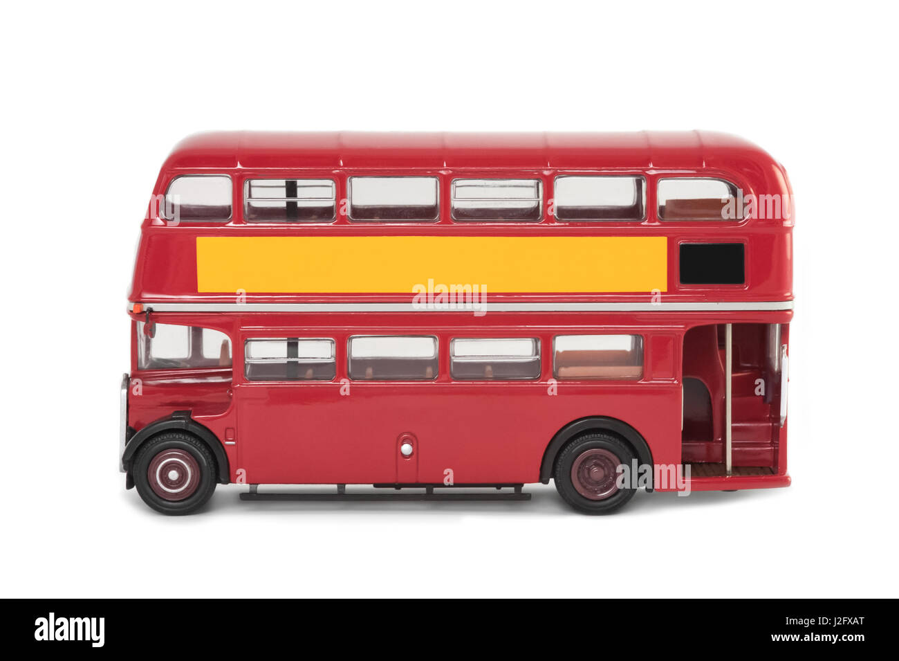 miniature scale model of a vintage red london bus on white - Stock Image