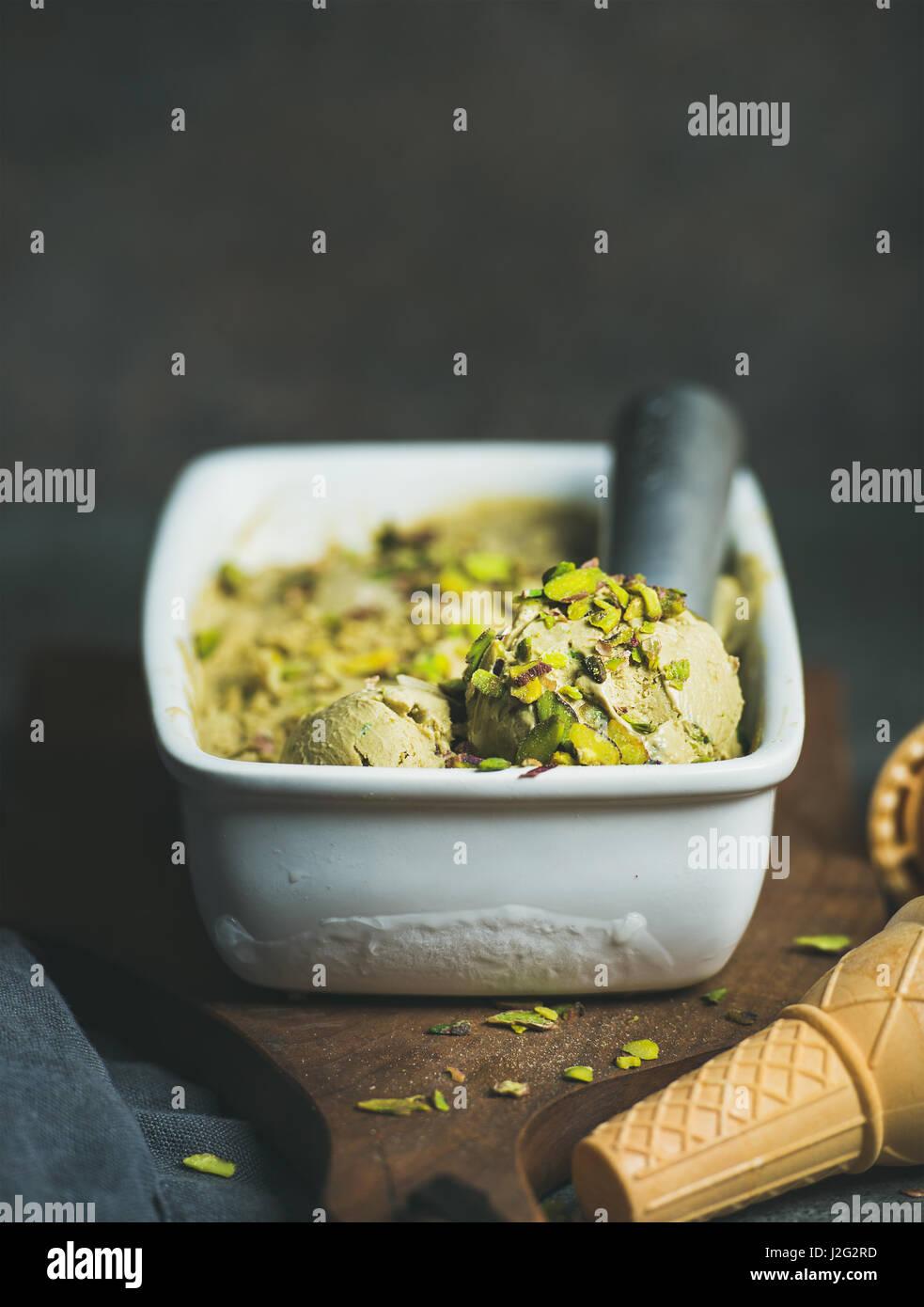Homemade pistachio ice cream in ceramic mold - Stock Image