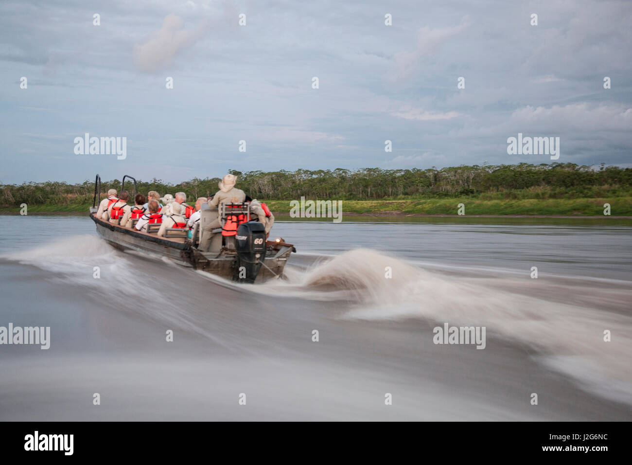 This is a group of tourists exploring the Maranon River in the Amazon Rainforest. - Stock Image
