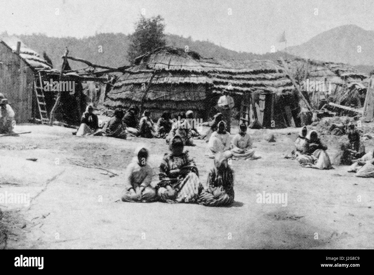 1875 black and white historic photograph of a traditional Pomo Indian  Village, California