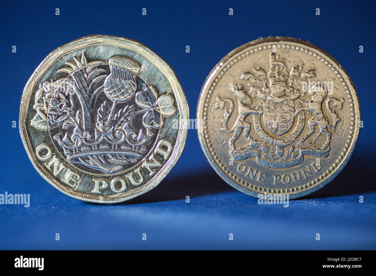 New pound coin 2012, 12 sided with old pound coin - Stock Image