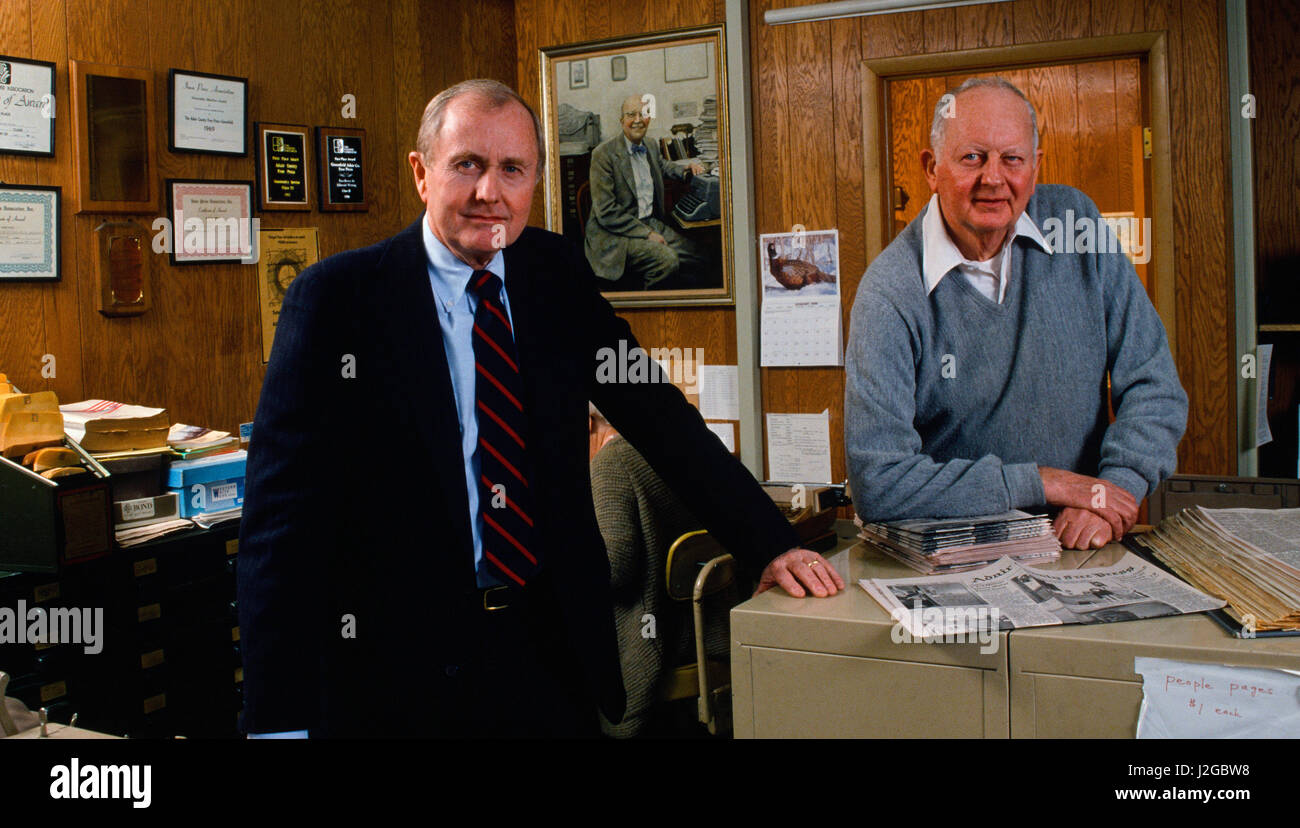 Hugh Sidey his brother Edwin pose at the counter of the Adair County (Iowa) Free Press, during the Iowa Caucus Season. - Stock Image