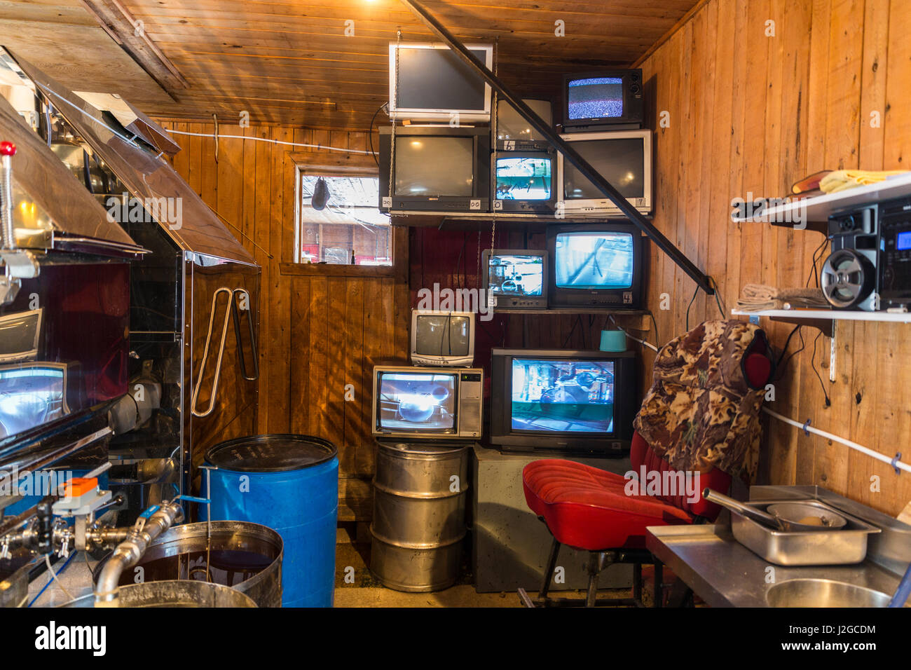Closed circuit televisions transmit live video from sap pump houses to the sugarhouse at the LaRiviere maple syrup - Stock Image