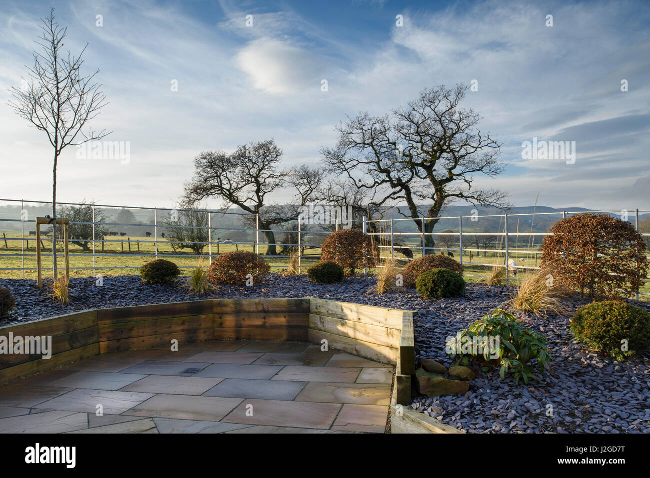 Winter sun on beautiful, private garden, Yorkshire, England, UK - stylish, contemporary design, hard landscaping - Stock Image