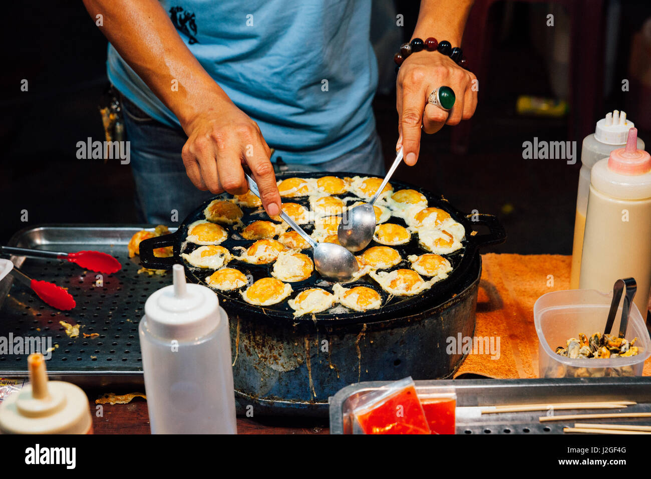 CHIANG MAI, THAILAND - AUGUST 21: Food vendor cook quail eggs at the Sunday Market (Walking Street) on August 21, - Stock Image