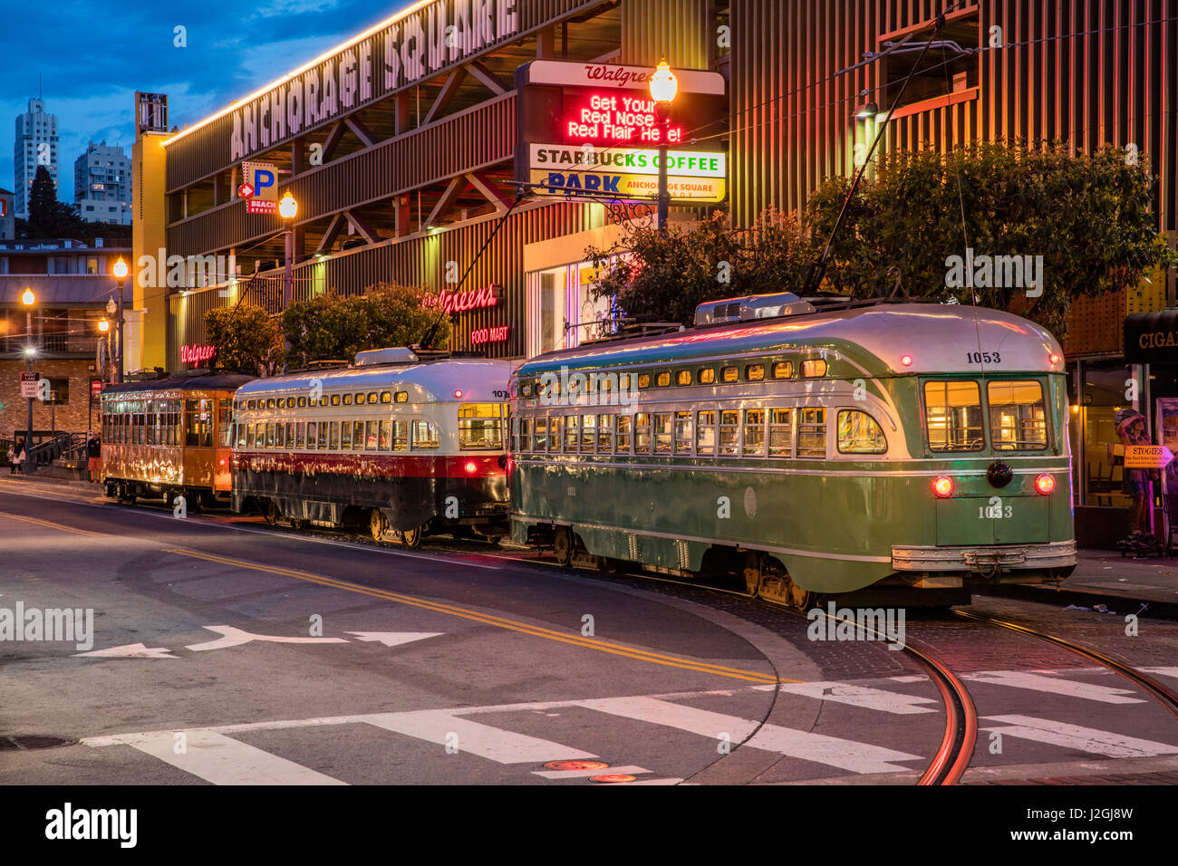 Historic streetcars line up in Fisherman's Wharf in San Francisco, California, USA (Large format sizes available) - Stock Image