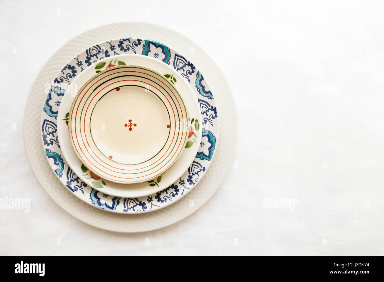 Stack of empty ceramic plates isolated on white background with copy space. Cheerful colorful dishes & Colorful Art Ceramic Plates Stock Photos u0026 Colorful Art Ceramic ...