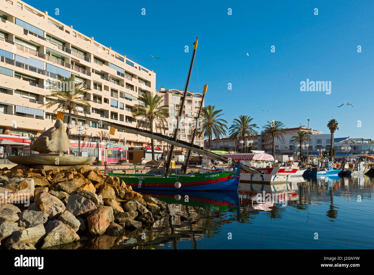 The fishing harbour at Saint Cyprien and the fountain dated 1991 by Yasmine Hurbourg, Jean Pelletier, Charles Cervantes - Stock Image
