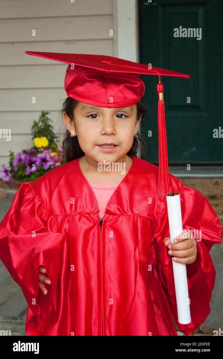 Kindergarten age Native American child dressed in a graduation cap ...