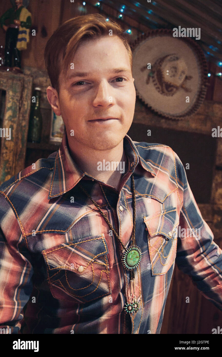 Portrait of a handsome young man in a western outfit, Santa Fe, New Mexico, USA. (MR) - Stock Image