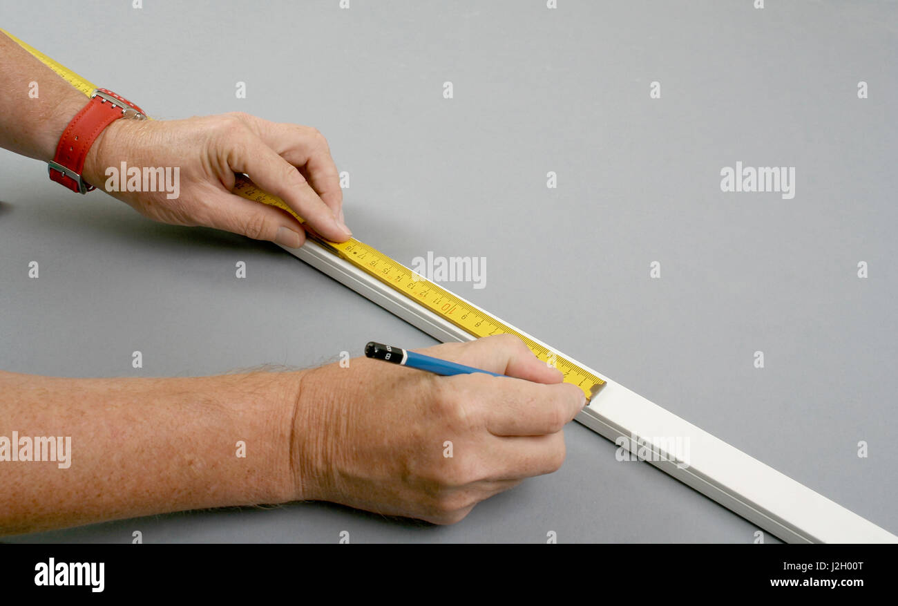 handyman measuring surface mount plastic electric wiring channel