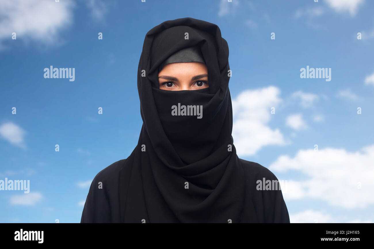 muslim woman in hijab over white background - Stock Image