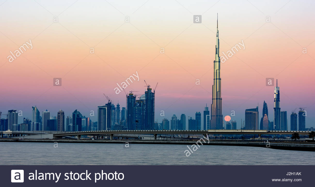 Moon passing behind Burj Khalifa, picture taken early morning from Al Jadaf - Stock Image
