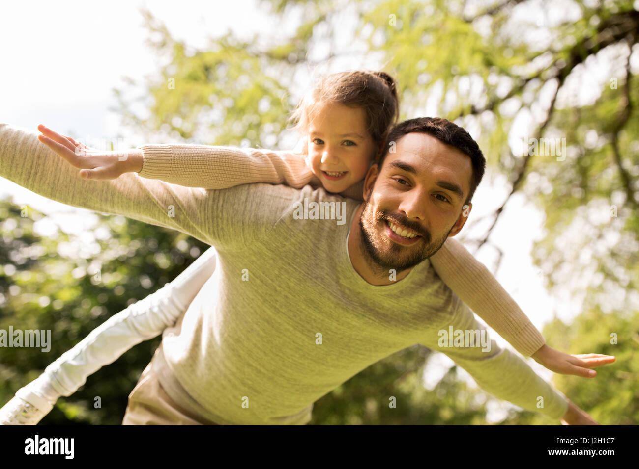 happy family having fun in summer park - Stock Image