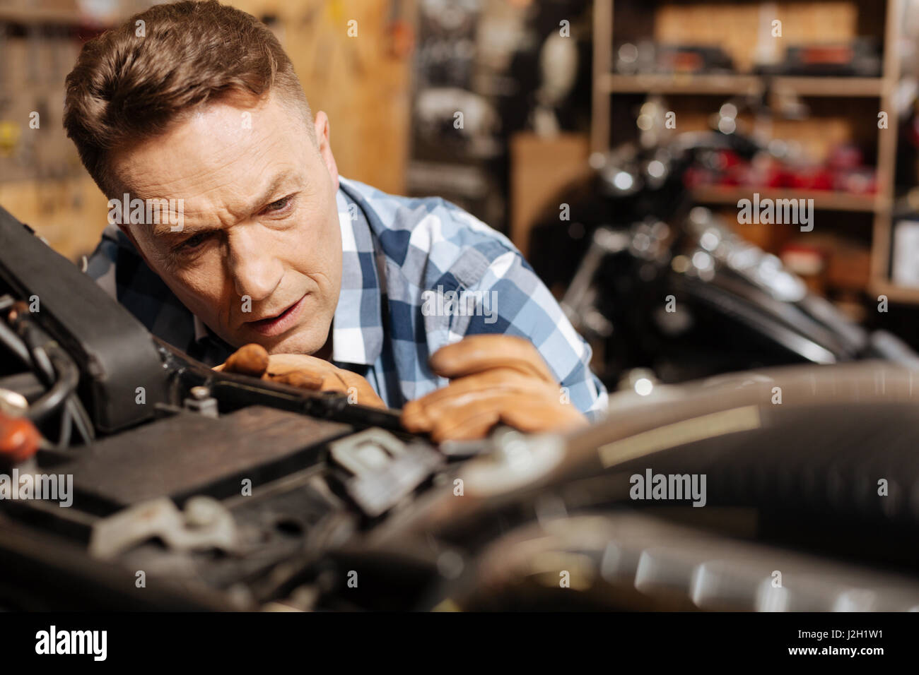 Skillful amateur mechanic making his bike perfect - Stock Image