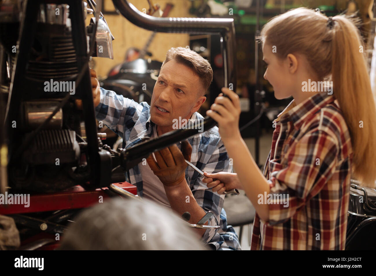 Trained skillful mechanic needing a special tool - Stock Image