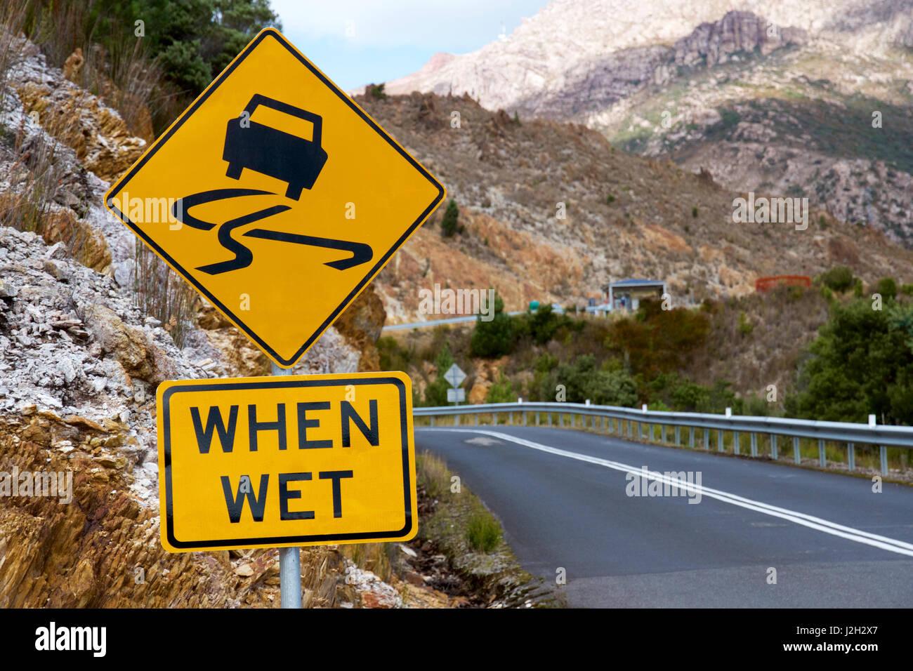 Slippery when wet sign in Tasmania, Australia - Stock Image