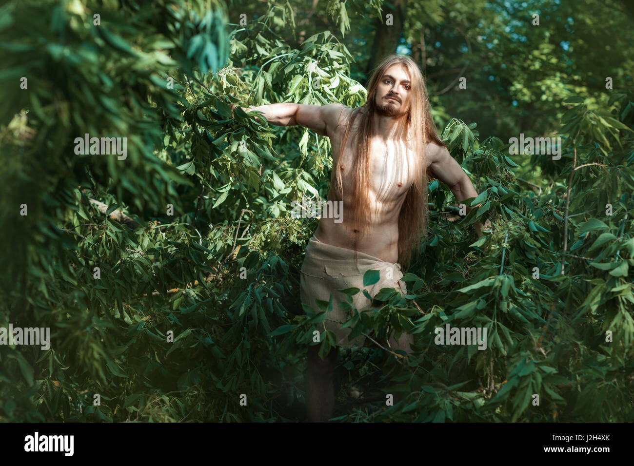 White man living in the woods like a savage. - Stock Image