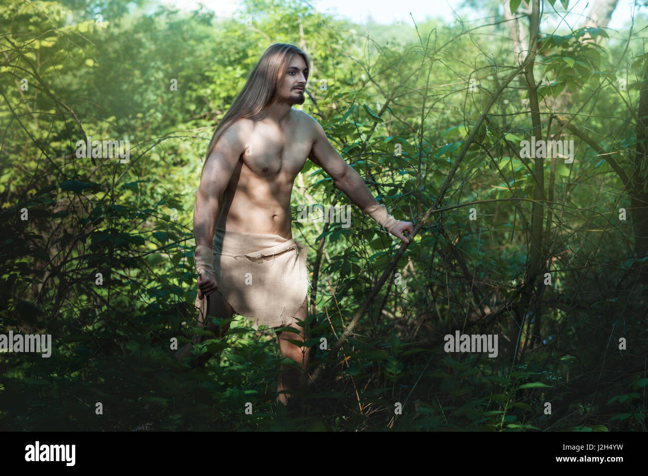European man became wild, and lives in the forest. - Stock Image