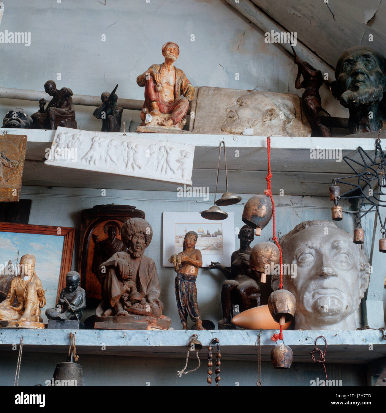 Shelves of figurines. - Stock Image