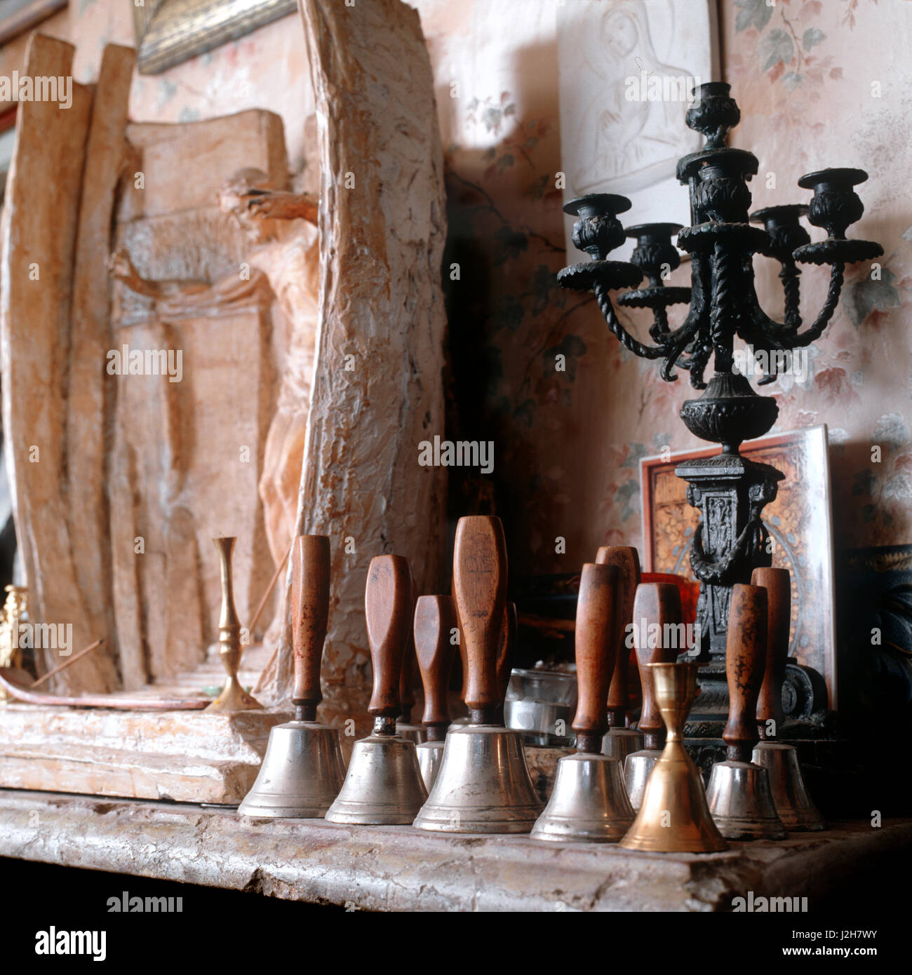 Bells and candelabra on mantelpiece. - Stock Image