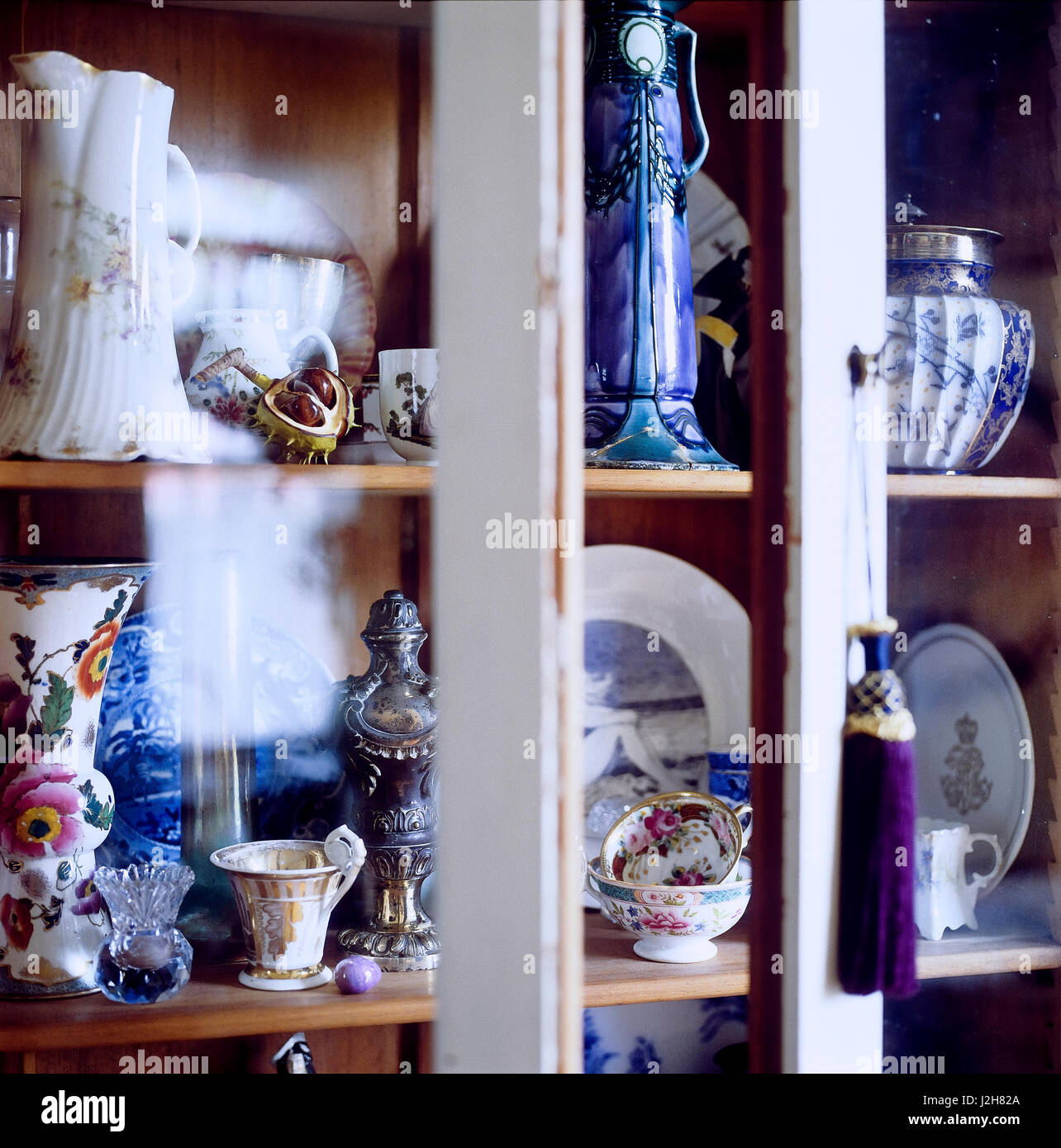 Shelves of vases and tableware. - Stock Image