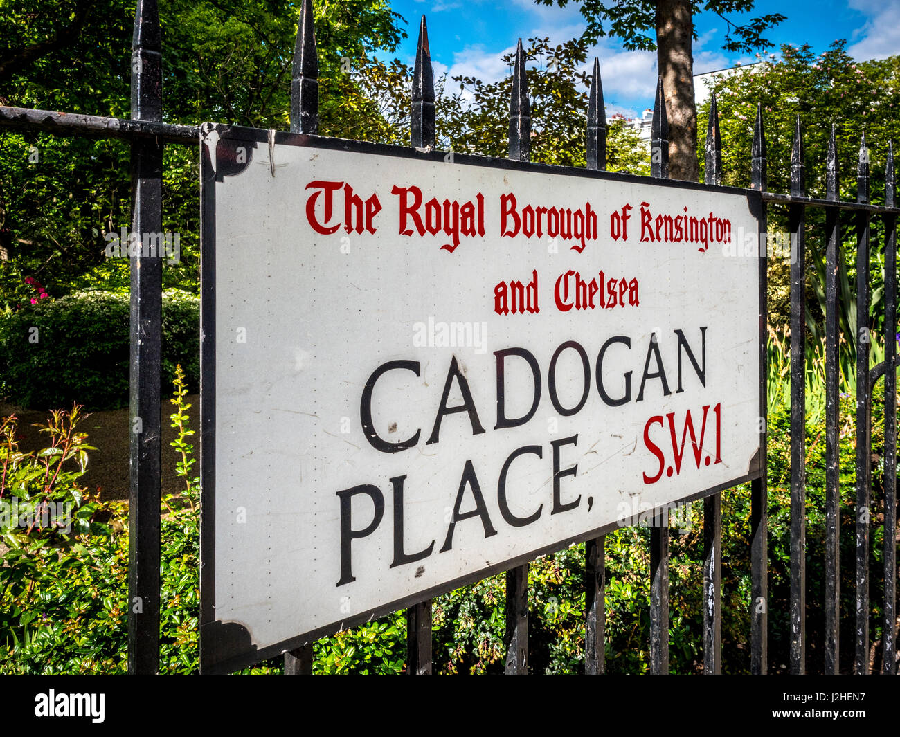 Cadogan Place street sign on railings of private residents only garden, London, UK. - Stock Image