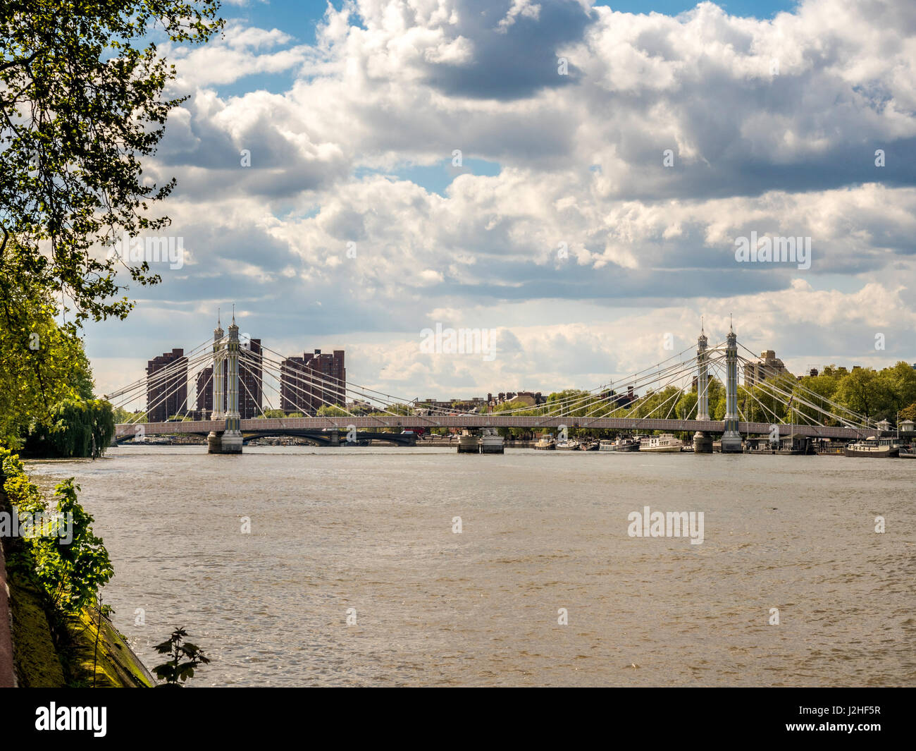 The Albert Bridge over the River Thames in West London, connecting Chelsea  to Battersea. - Stock Image