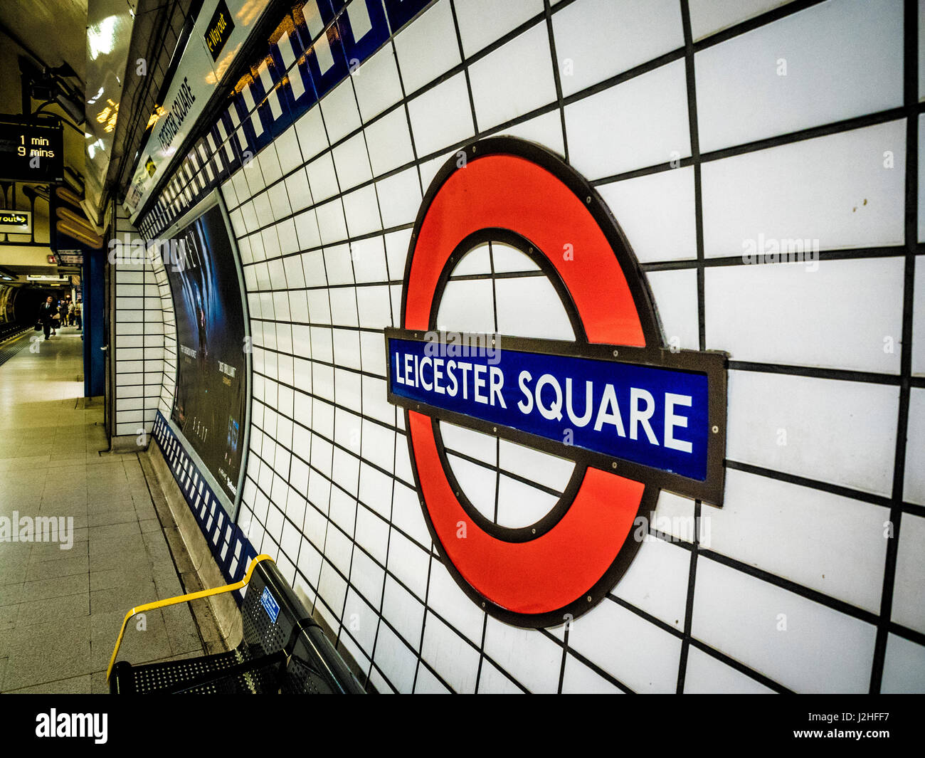 Leicester Square tube station logo on station wall, London, UK. Stock Photo