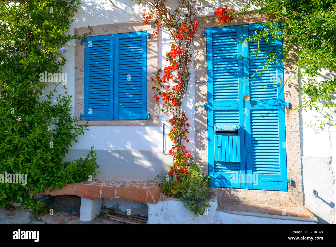 Typical Mediterranean house with white walls and blue fixtures Stock